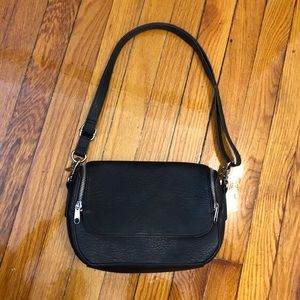 Black shoulder bag with zippers